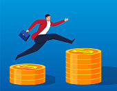 The businessman jumps to the higher pile of gold coins