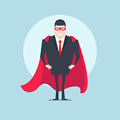 The businessman standing with red cloak or cape and eye.