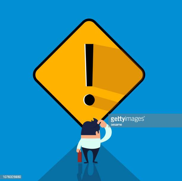 the businessman was blocked by the yellow exclamation mark - occupational safety and health stock illustrations, clip art, cartoons, & icons