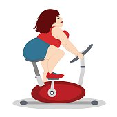 The fat girl is training on a stationary bike.