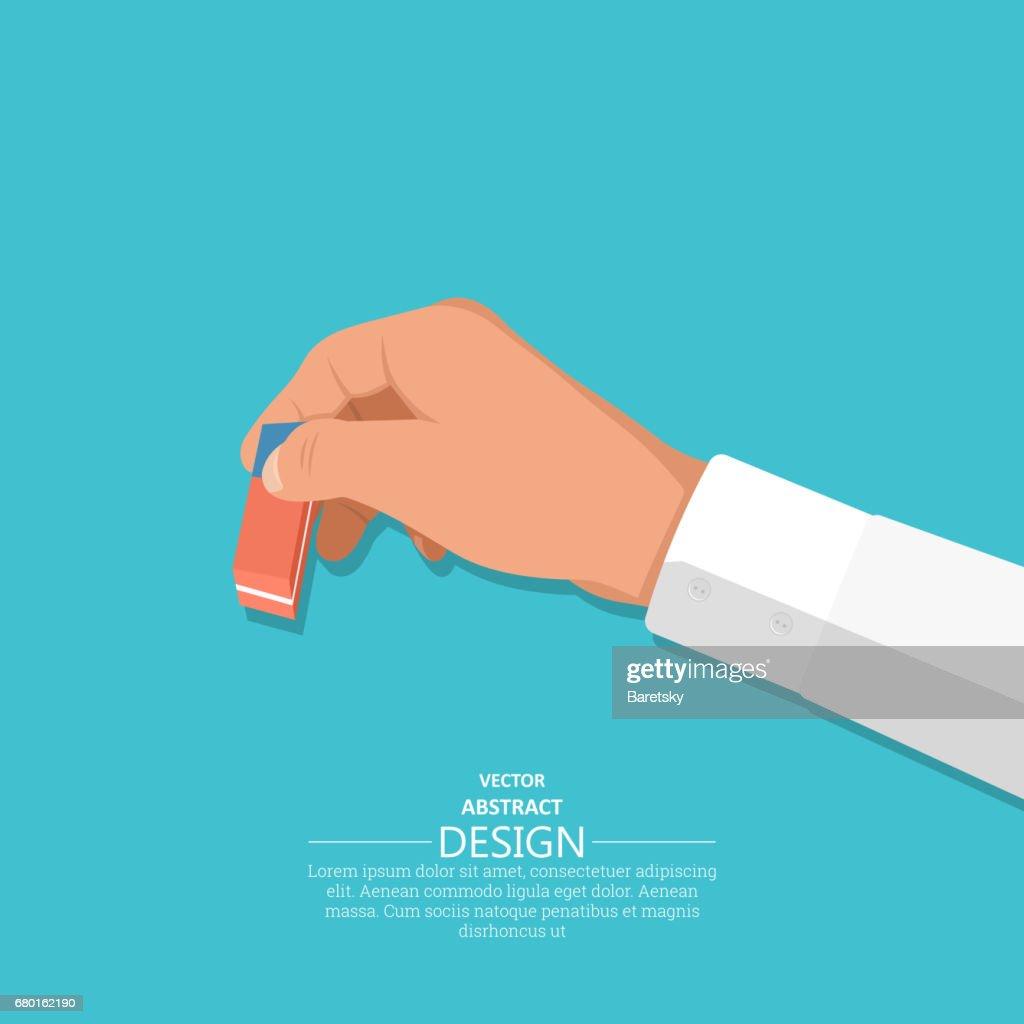 The hand holds an eraser