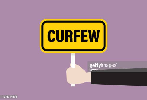 the human hand holds a curfew sign - curfew stock illustrations