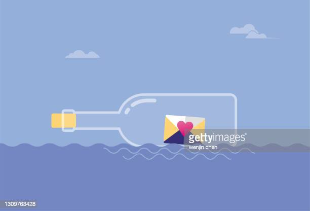 the letters in the drifting bottle are floating in the sea. - driftwood stock illustrations