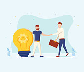 The man is holding a huge light bulb and shaking hands with a businessman with briefcase. Startup and search investments