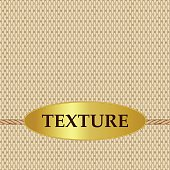 The texture of the burlap with a gold label on a string.