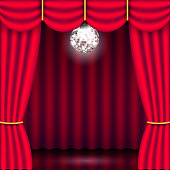 Theater stage, red curtain and mirror ball