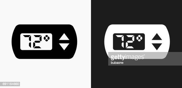 thermostat icon on black and white vector backgrounds - temperature stock illustrations, clip art, cartoons, & icons