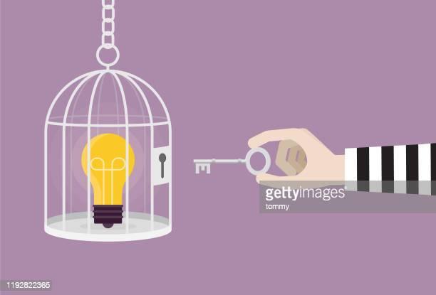 illustrazioni stock, clip art, cartoni animati e icone di tendenza di un ladro con una chiave sblocca una lampadina da una gabbia - proprietà intellettuale