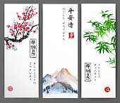 Three banners with blossoming sakura, bamboo and mountains. Traditional oriental