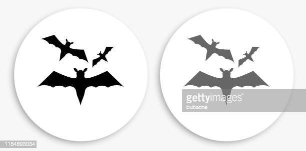 Three Bats Flying Black and White Round Icon