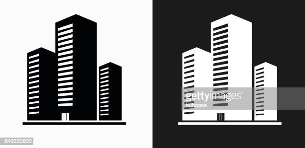 three buildings icon on black and white vector backgrounds - skyscraper stock illustrations
