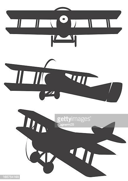 Three classic propeler biplane silhouetes