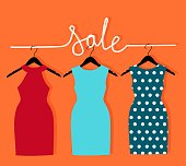 three dresses on a hanger and an inscription sale.