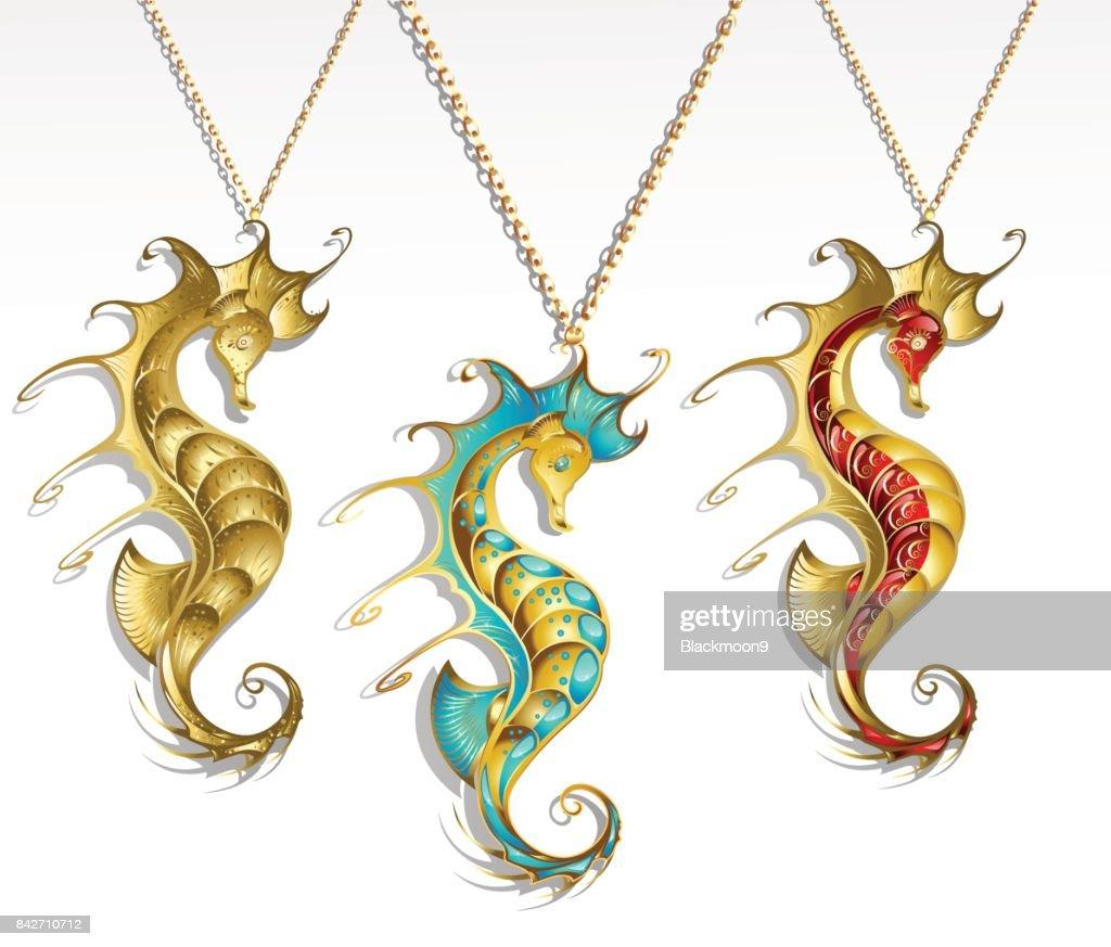 three gold seahorses
