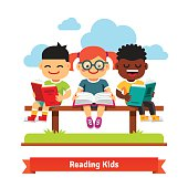 Three kids sitting on the bench and reading books