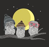 Three owl friends on the tree in the night forest.