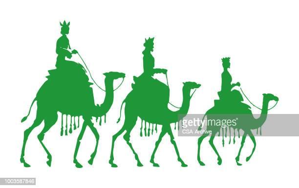 ilustraciones, imágenes clip art, dibujos animados e iconos de stock de tres personas en camellos - los tres reyes magos