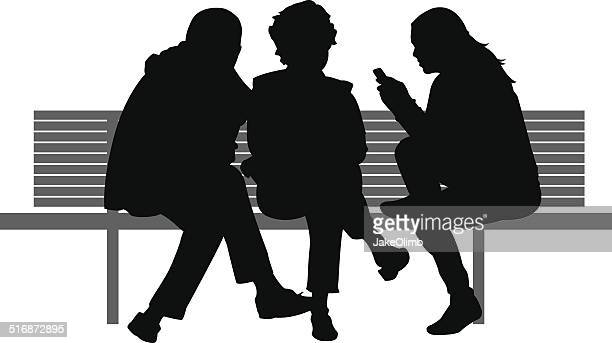 Three People Sitting on Bench