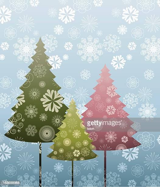 three pine trees and snow