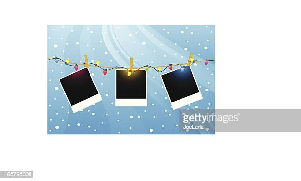 three polaroids hanging from christmas lights - polaroid stock illustrations, clip art, cartoons, & icons