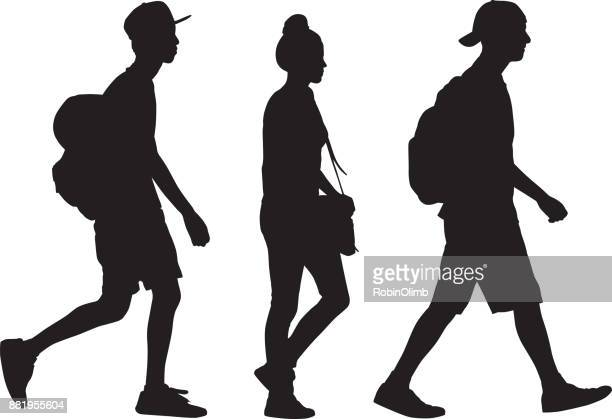three teens walking silhouette - side view stock illustrations