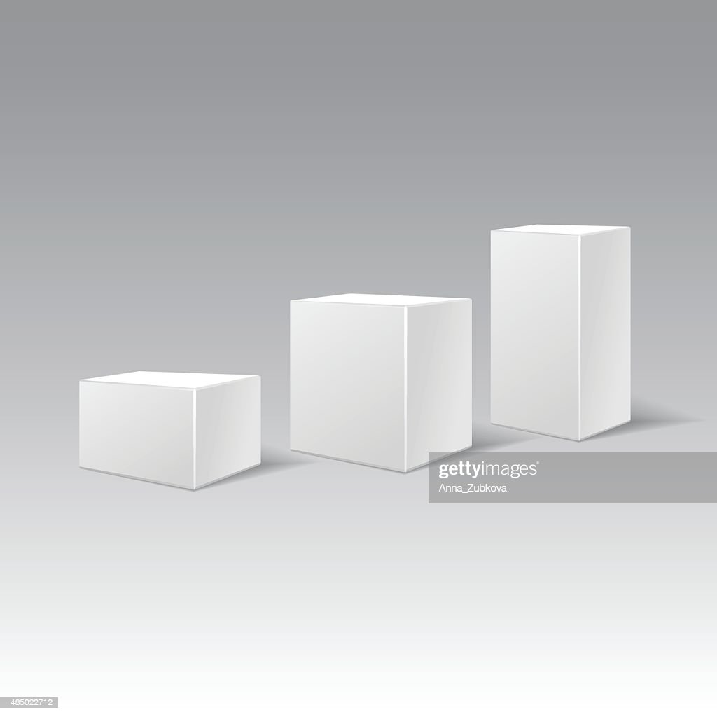Three white cardboard gift rectangular boxes different height