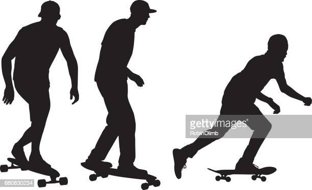 Three Young Men Riding Skateboards