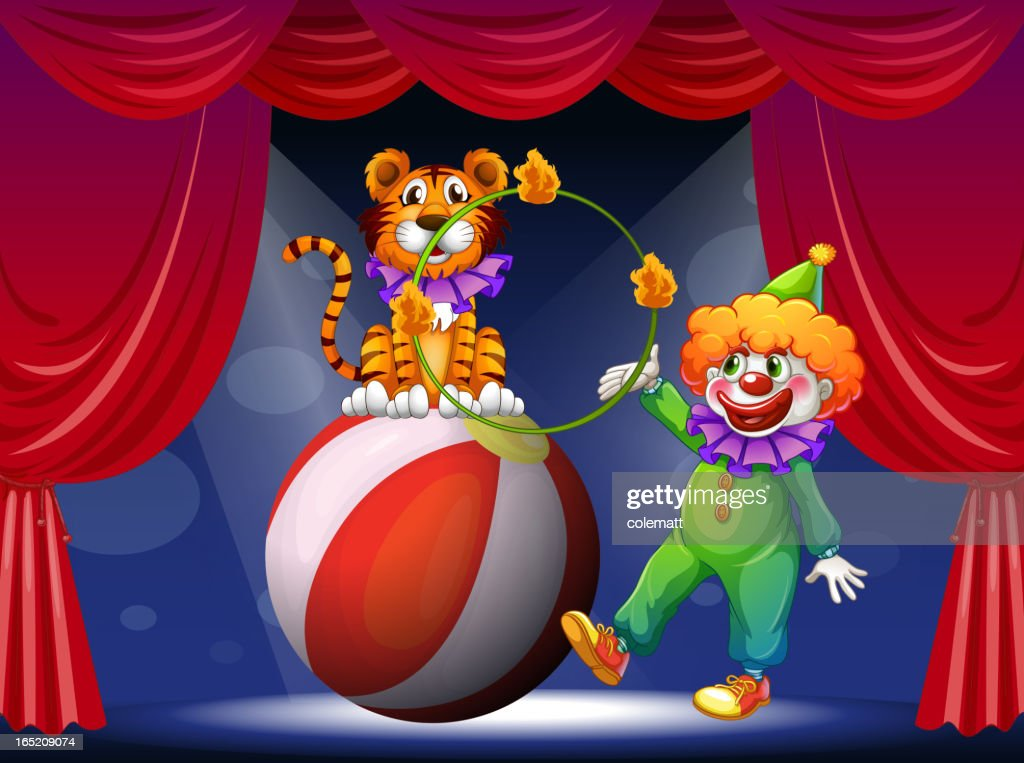 Tiger and a clown performing at the stage