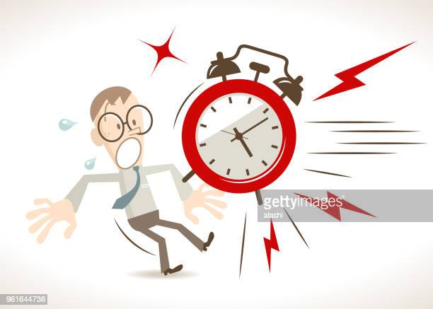 Time Management, a big alarm clock suddenly appeared in front of the businessman (student)