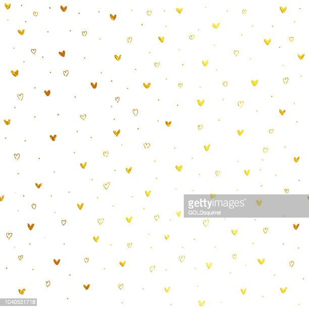 tiny hand drawn uneven gold heart shapes on white paper background - seamless luxury and minimalistic love card design in vector - purity stock illustrations