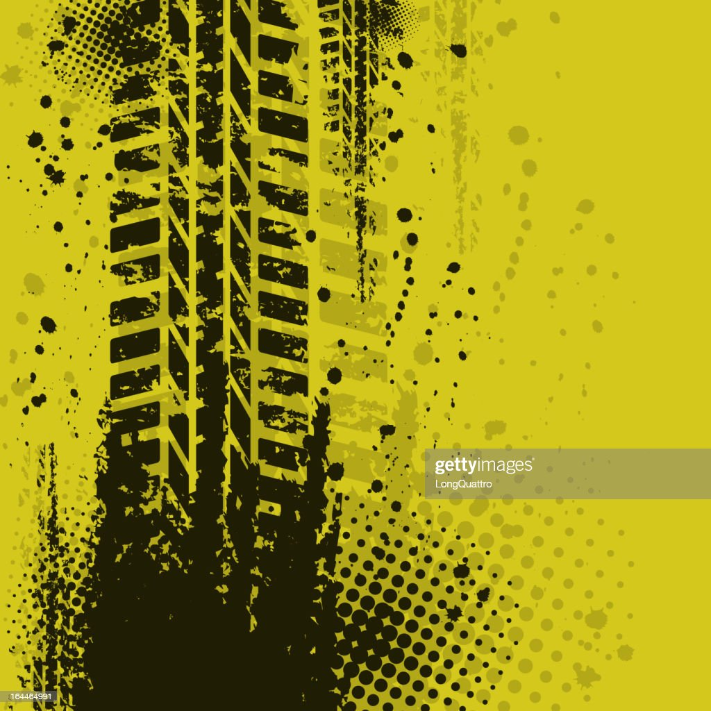 Tire track over a dirty yellow background