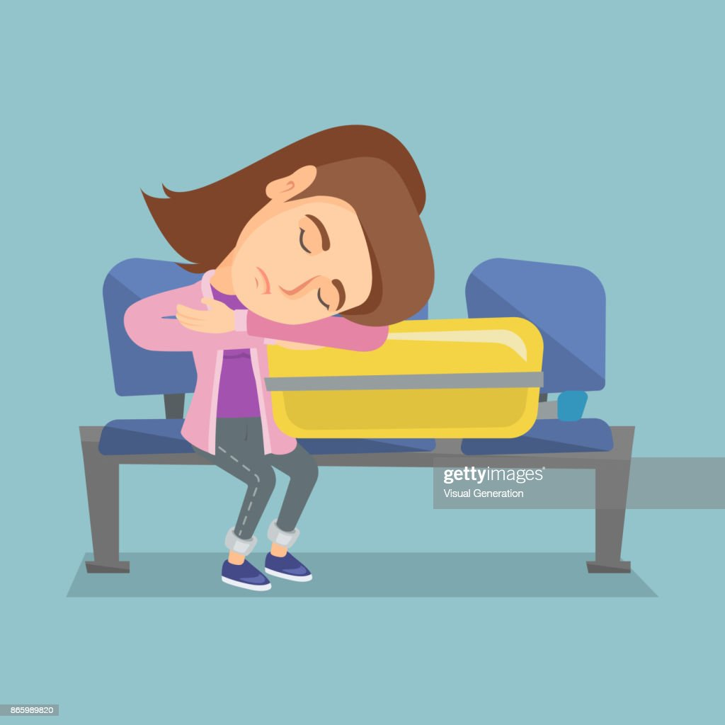 Tired woman sleeping on suitcase at the airport