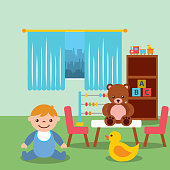 toddler boy in classroom kinder bear duck blocks toys
