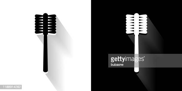 toilet brush  black and white icon with long shadow - toilet brush stock illustrations, clip art, cartoons, & icons