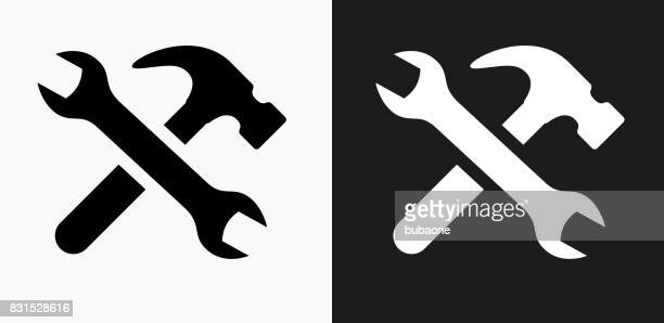 tools and hardware icon on black and white vector backgrounds - wrench stock illustrations