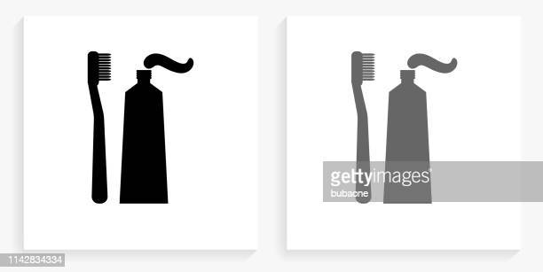 toothbrush & paste black and white square icon - toothpaste stock illustrations