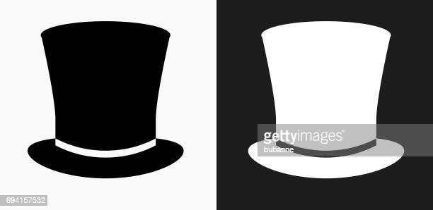 top hat icon on black and white vector backgrounds - hat stock illustrations