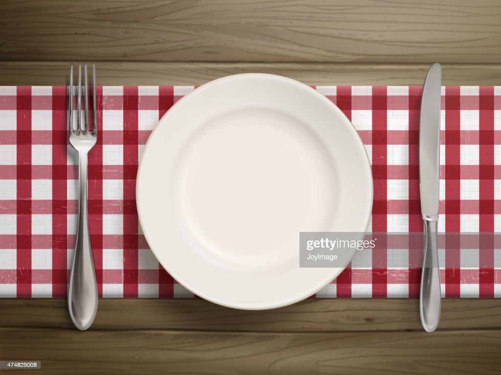 top view of empty plate with spoon and knife