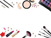 Top view of various make up accessories decorative cosmetics products. Workplace, cosmetics, lipstick, nail polish, mascara, face powder and eyeshadow on white background.