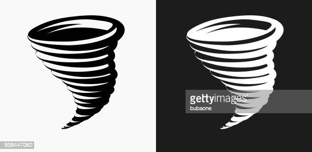 tornado icon on black and white vector backgrounds - tornado stock illustrations