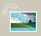 Tornado passing by farm and distant rainbow. Kansas, United States