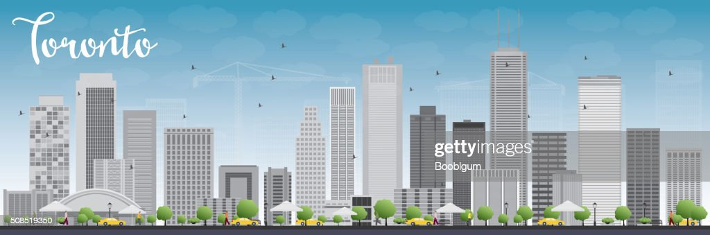 Toronto skyline with grey buildings and blue sky.