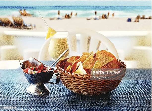 tortilla chips, salsa and a pina colada at the beach - dipping stock illustrations, clip art, cartoons, & icons