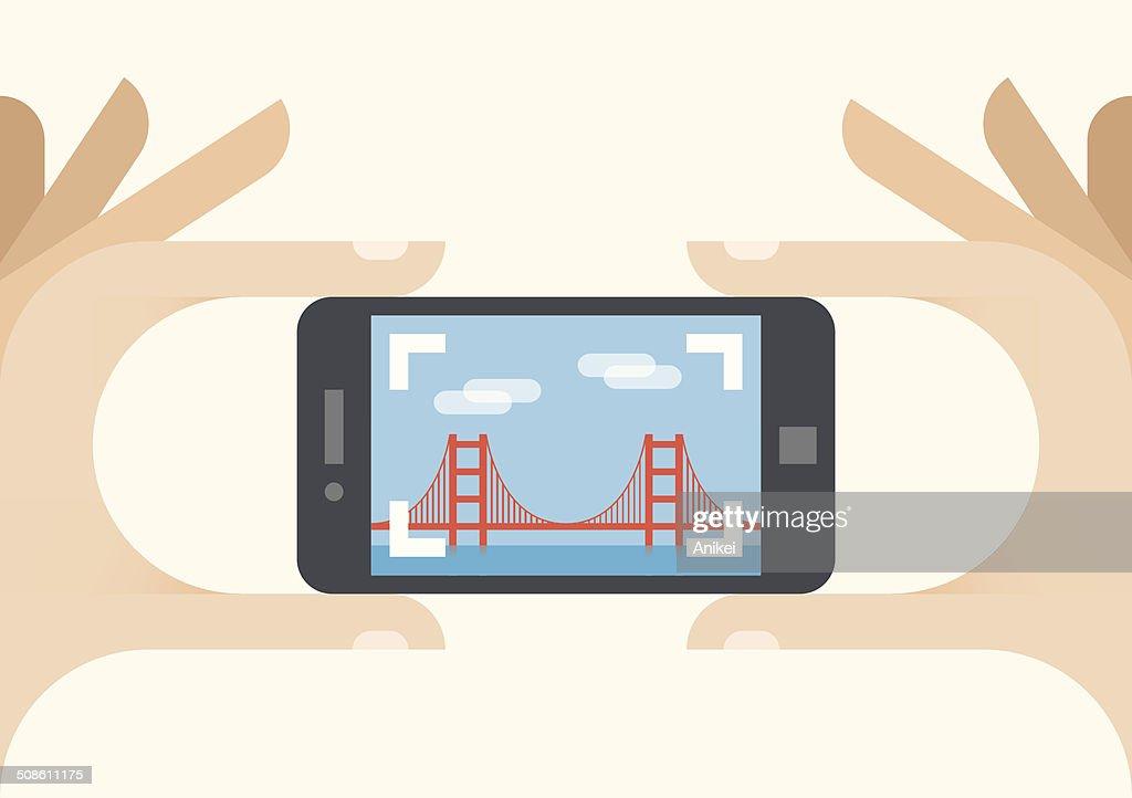 Tourist with mobile phone camera. Photo of Golden Gate bridge : Vector Art