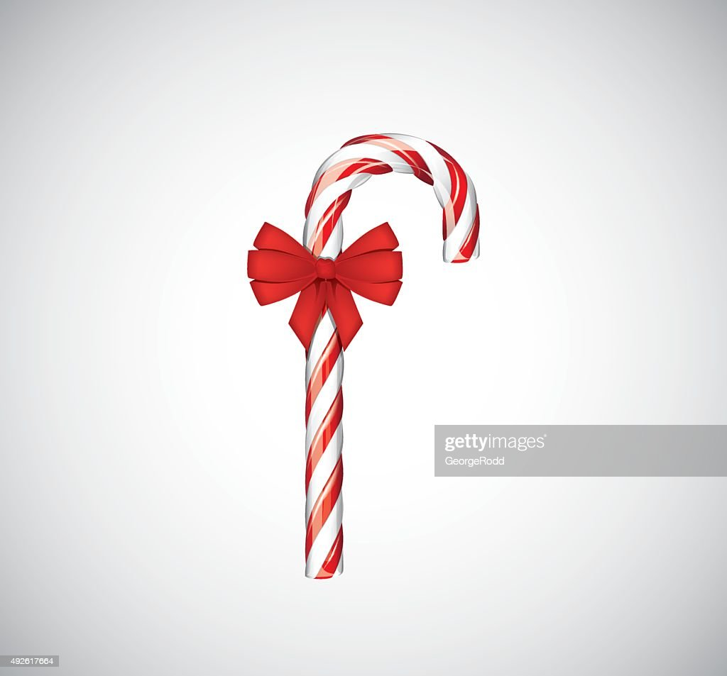 traditional christmas candy canes with red bow vector art