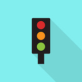 Traffic light icon with long shadow on blue background, flat design style