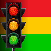 Traffic light on striped background