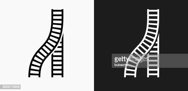 train tracks icon on black and white vector backgrounds - railroad track stock illustrations