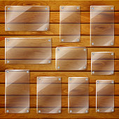 Transparent glass plates on wooden planks