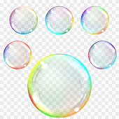 Transparent soap bubbles. Realistic illustration on checkered background. Set of multicolored transparent glass spheres. Transparency only in vector format. Can be used with any background.